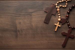 crosses-over-brown-wooden-background-PKYNPNQ